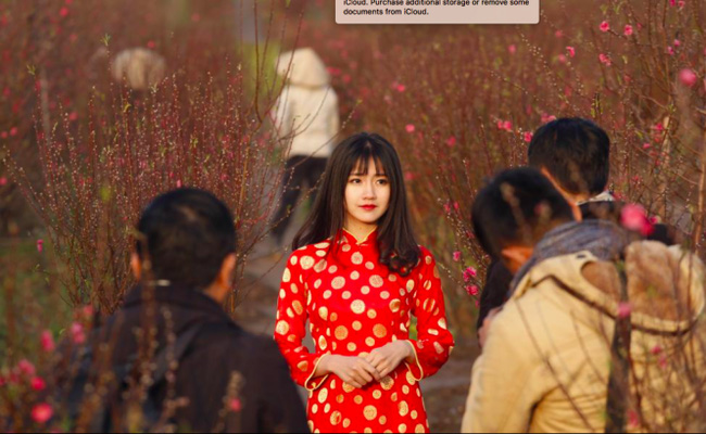 Hình ảnh hot girl Kiều Trinh diện áo dài đỏ xuất hiện trên hãng thông tấn lớn nhất thế giới - Ảnh 2.