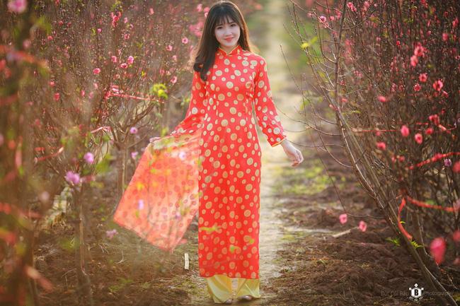 Hình ảnh hot girl Kiều Trinh diện áo dài đỏ xuất hiện trên hãng thông tấn lớn nhất thế giới - Ảnh 3.