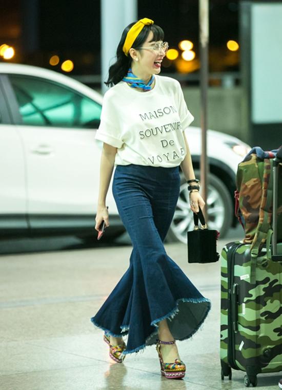 Angela Phương Trinh dìm chiều cao bằng quần loe quá khổ, Đỗ Mỹ Linh chững chạc với tóc uốn xoăn - Ảnh 3.
