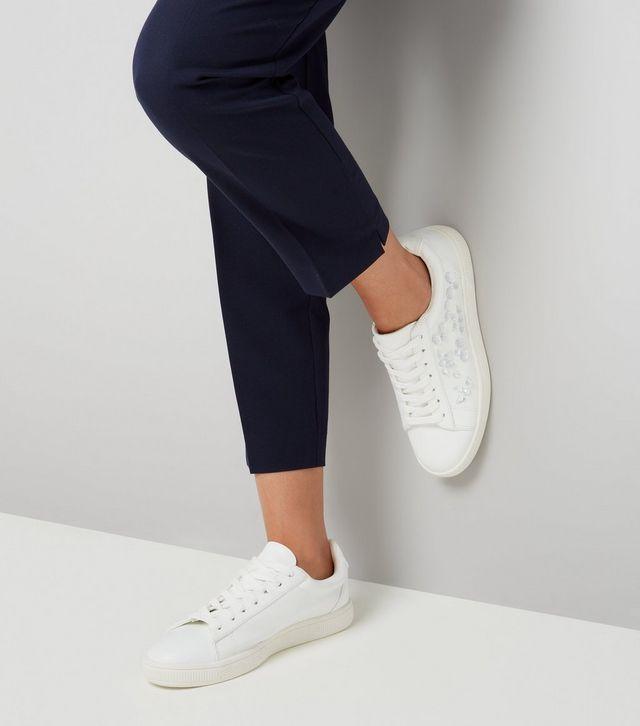 Loạt thương hiệu bình dân đã tung ra nhiều mẫu giày thể thao trắng cho các nàng tha hồ lựa chọn - Ảnh 16.