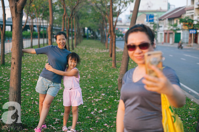 Một ngày nắng chói chang, ngắm hoa kèn hồng để thấy lòng lịm mát giữa Sài Gòn - Ảnh 13.