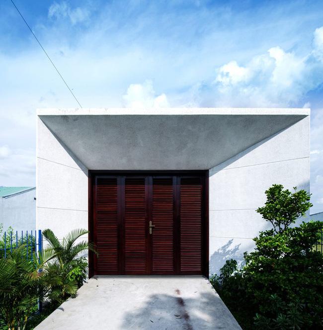Ngôi nhà 200m² lấy cảm hứng thiết kế từ hang Sơn Đoòng ở Vĩnh Long nổi bật trên báo Mỹ - Ảnh 1.