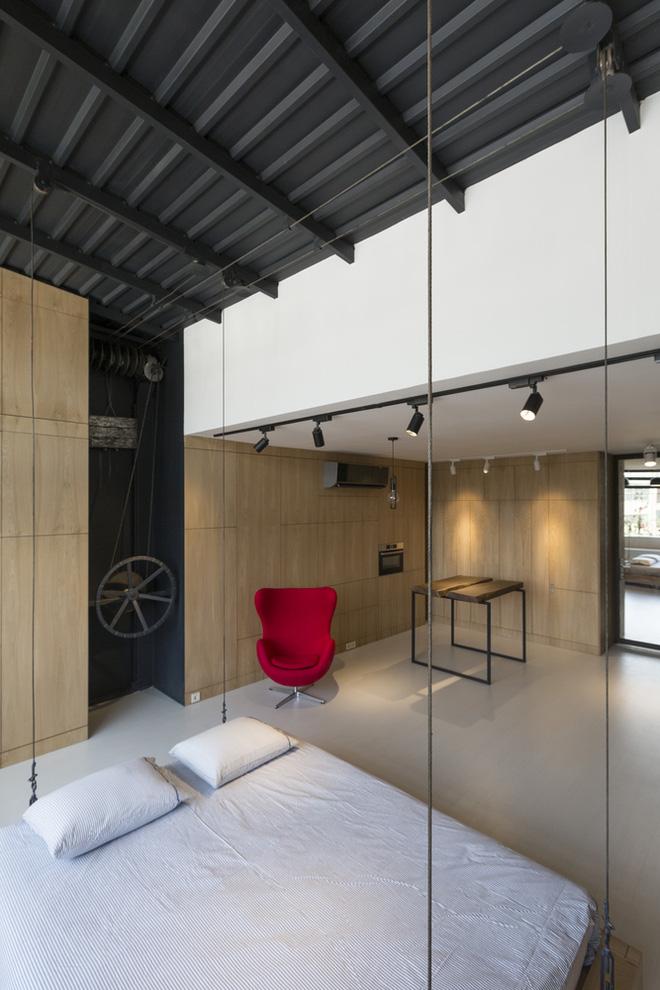 Căn hộ 45m² cực ấn tượng với giường treo và hệ tủ âm tường biến hóa khôn lường - Ảnh 6.
