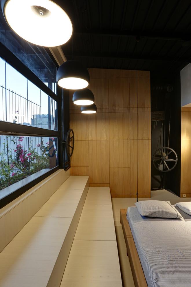 Căn hộ 45m² cực ấn tượng với giường treo và hệ tủ âm tường biến hóa khôn lường - Ảnh 17.