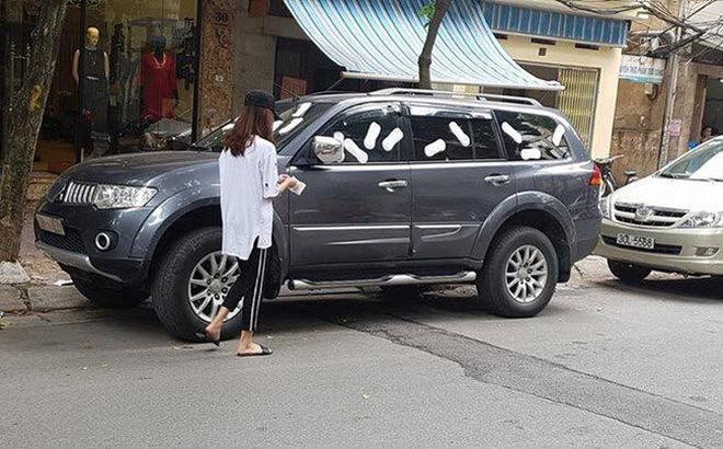 Không xử phạt cô gái trẻ dán băng vệ sinh lên xe ô tô đậu trước cửa nhà gây xôn xao dư luận - Ảnh 1.