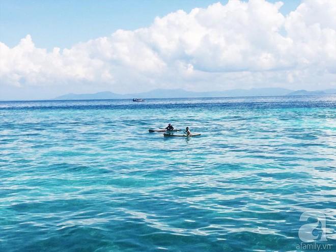 Cô gái Việt đến đảo thiên đường Sipadan bơi cùng cá mập, ở resort hạng sang, ăn buffet xả láng cả tuần với 12 triệu - Ảnh 1.