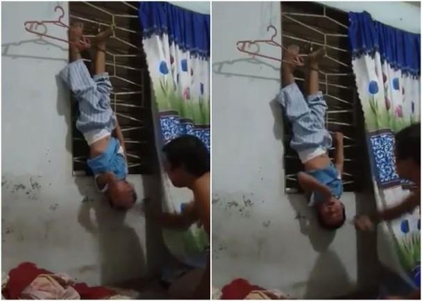 Hết bé gái bao cát, đến đoạn clip bé trai bị bố treo ngược lên cửa sổ, đánh tới tấp để trả thù người mẹ gây phẫn nộ cực độ - Ảnh 3.