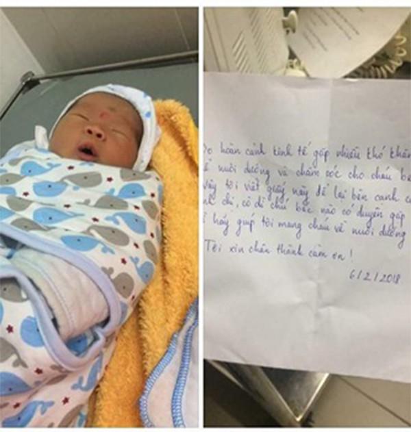 Hà Nội: Bé trai sơ sinh bị bỏ rơi trong túi xách trước cửa gia đình hiếm muộn - Ảnh 1.