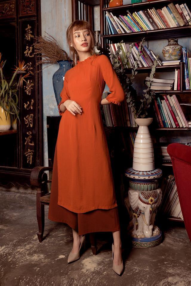 Còn đúng 1 tháng nữa là Tết, và đây là 7 mẫu áo dài cách tân đẹp duyên nhất cho nàng diện trong Tết này - Ảnh 35.