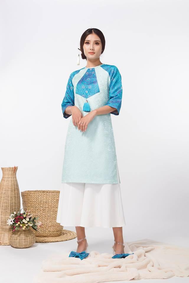 Còn đúng 1 tháng nữa là Tết, và đây là 7 mẫu áo dài cách tân đẹp duyên nhất cho nàng diện trong Tết này - Ảnh 26.