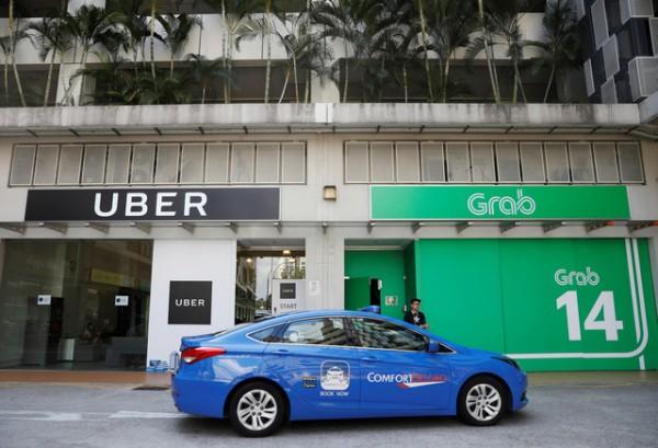 Trước ngày Uber sáp nhập vào Grab: Người tiêu dùng hoang mang, lái xe 2 hãng lo lắng chuyện độc quyền - Ảnh 1.