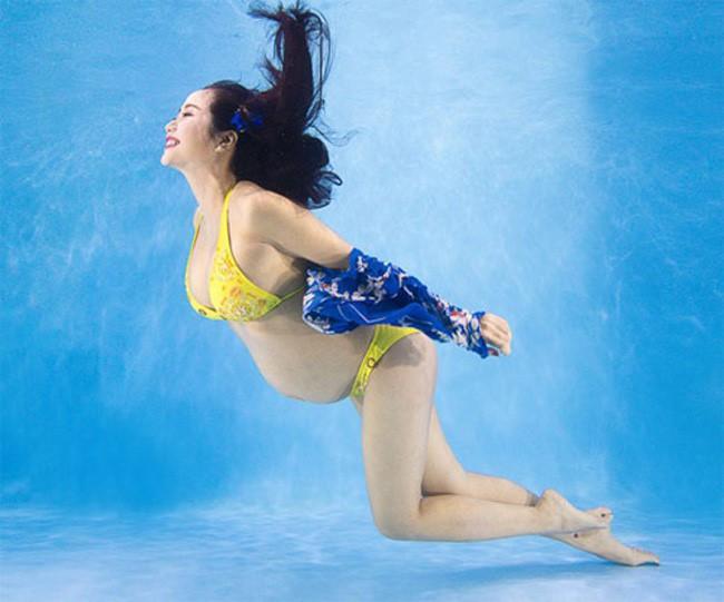 Chẳng ngại bụng to, loạt bà bầu Vbiz này vẫn rất chăm diện bikini khoe hình thể - Ảnh 5.