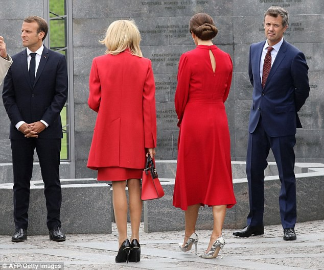 4f75a5e500000578-6106001-red_is_the_colour_brigitte_macron_centre_left_and_crown_princess-a-1_1535471841232