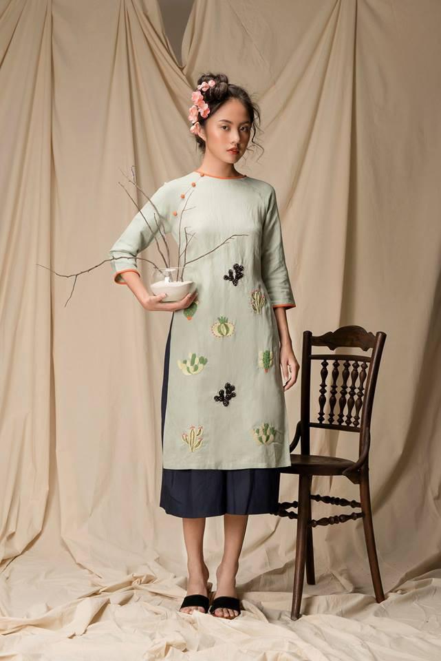 Còn đúng 1 tháng nữa là Tết, và đây là 7 mẫu áo dài cách tân đẹp duyên nhất cho nàng diện trong Tết này - Ảnh 6.