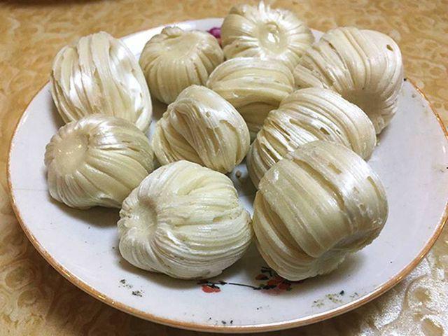 Sự khác biệt trong phong tục thờ cúng Táo Quân của Trung Quốc và Việt Nam: Đốt ngựa giấy, mâm cơm cúng đầy đồ ngọt - Ảnh 3.