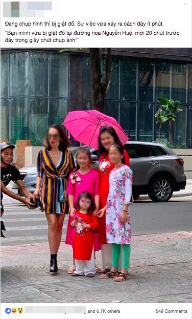 """""""Khoảnh khắc vàng"""": Thanh niên đang thò tay giật túi xách ở đường hoa Nguyễn Huệ thì lọt trọn vào khung hình - Ảnh 1."""