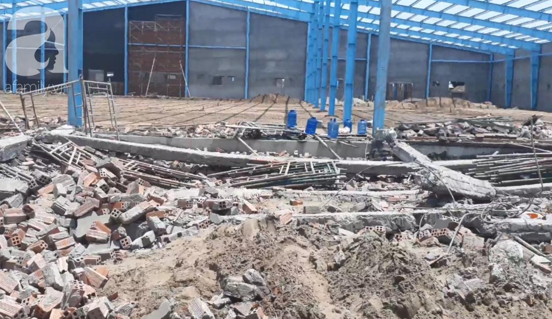 Hiện trường vụ sập bức tường rộng 400m2, 6 người chết, nhiều người bị vùi lấp trong gạch đá - Ảnh 4.