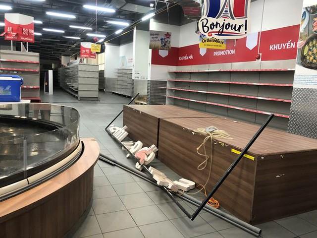 Hình ảnh siêu thị Auchan sau nhiều ngày tháo khoán rút khỏi Việt Nam - Ảnh 14.