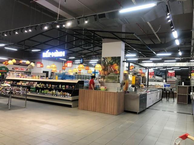 Hình ảnh siêu thị Auchan sau nhiều ngày tháo khoán rút khỏi Việt Nam - Ảnh 8.