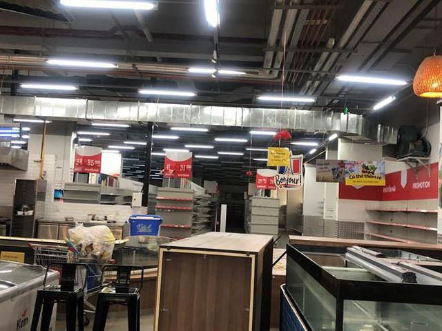 Hình ảnh siêu thị Auchan sau nhiều ngày tháo khoán rút khỏi Việt Nam - Ảnh 9.