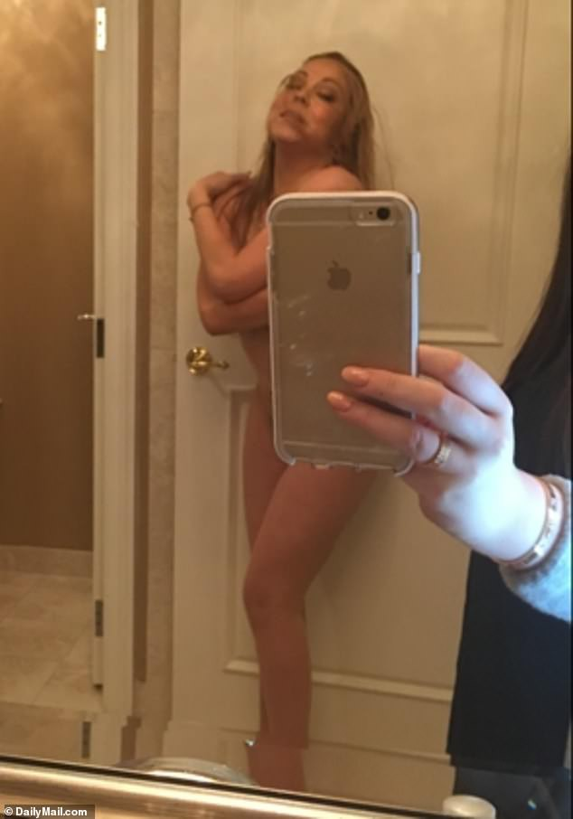 14602216-7117491-Another_shows_a_fully_naked_Carey_posing_in_a_bathroom_on_the_ya-a-31_1560195296936