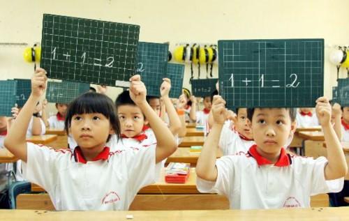 Hà Nội yêu cầu không dạy thêm, học thêm với học sinh tiểu học - Ảnh 1.