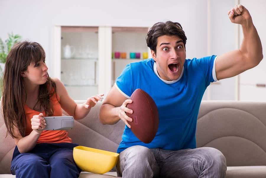 man-woman-watching-football