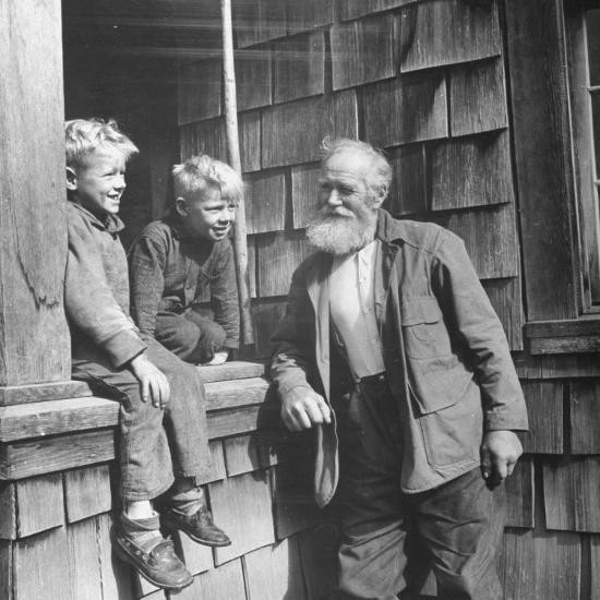 old-man-talking-to-two-young-boys_u-l-p75x5t0