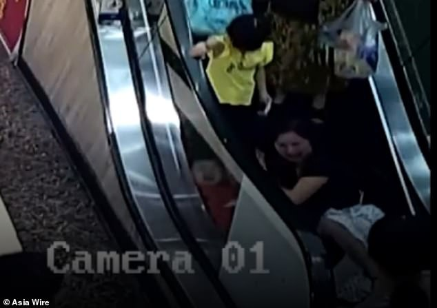 15780896-7225209-Surveillance_video_shows_the_two_year_old_riding_the_escalator_w-a-87_1562602237953 (1)