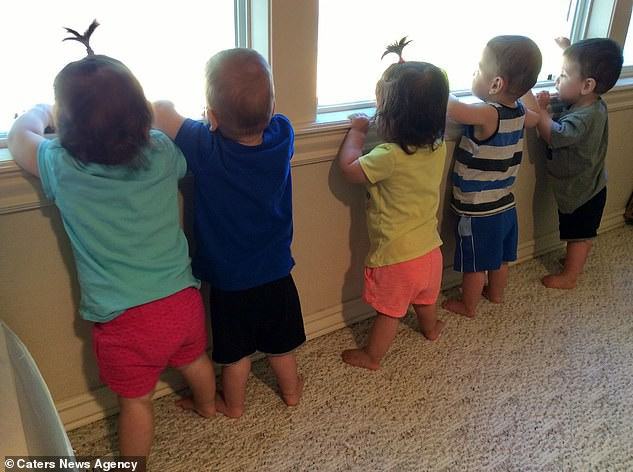 16153212-7255955-The_five_children_peering_out_of_the_window_at_home_pictured_The-a-26_1563364639822