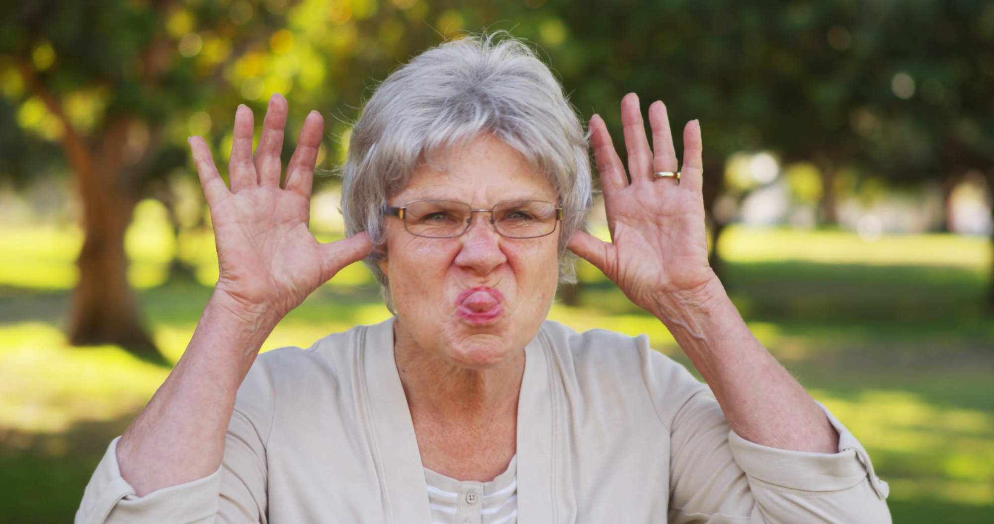 silly-grandma-making-funny-faces-at-the-camera_eybj0uifl__F0000