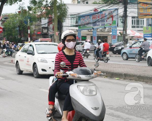 Hà Nội lạnh đột ngột: Kẻ mặc áo cộc, người khoác áo bông 6