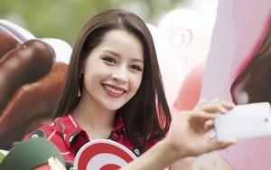 Mặc trời nắng nóng, Chi Pu vẫn diện áo đỏ rực hút mọi ánh nhìn trên phố đi bộ