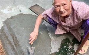 """Xôn xao clip cụ bà ngoài 80 tuổi tự trộn xi-măng """"vá"""" đường ở TP.HCM"""
