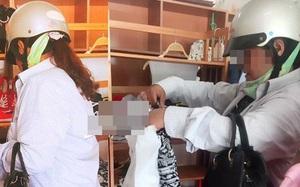 Giữa trưa nắng nóng, mẹ chồng đi mua áo cho con dâu khiến nhiều người xúc động