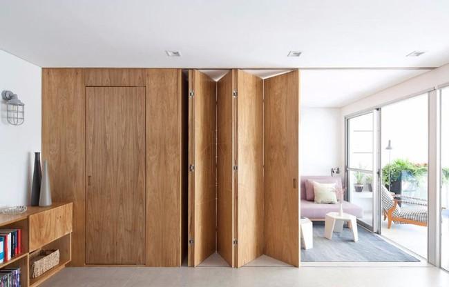 Chiếc vách cửa thần kì tạo ra không gian sống tuyệt vời cho ngôi nhà của cặp vợ chồng trẻ - Ảnh 1.