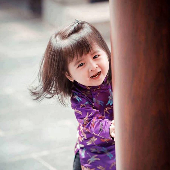 Khi các bé xúng xính trong tà áo dài ngày Tết, mẹ như thấy cả mùa xuân - Ảnh 34.