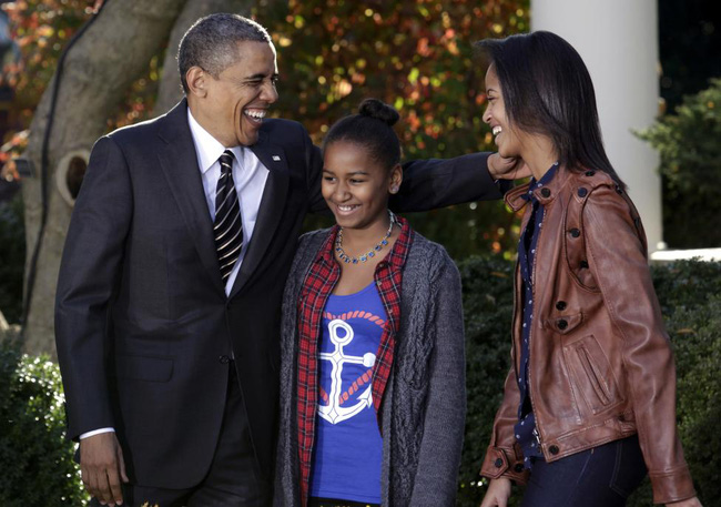 Những khoảnh khắc đáng nhớ bên vợ con của Obama - Ảnh 18.