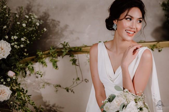 Mẫu váy cưới giúp tôn lên nét đẹp đoan trang, thoát tục mà Lan Khuê mặc được lấy cảm hứng từ Hoàng hậu cuối cùng của Việt Nam - Ảnh 4.