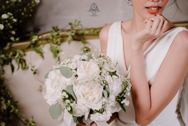 Mẫu váy cưới giúp tôn lên nét đẹp đoan trang, thoát tục mà Lan Khuê mặc được lấy cảm hứng từ Hoàng hậu cuối cùng của Việt Nam - Ảnh 5.