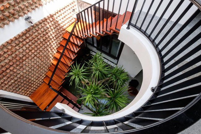 Ở đất Quảng Bình đầy nắng và gió vẫn xuất hiện ngôi nhà đẹp hoàn mỹ dù chỉ dùng gạch xây nhà để trang trí - Ảnh 7.