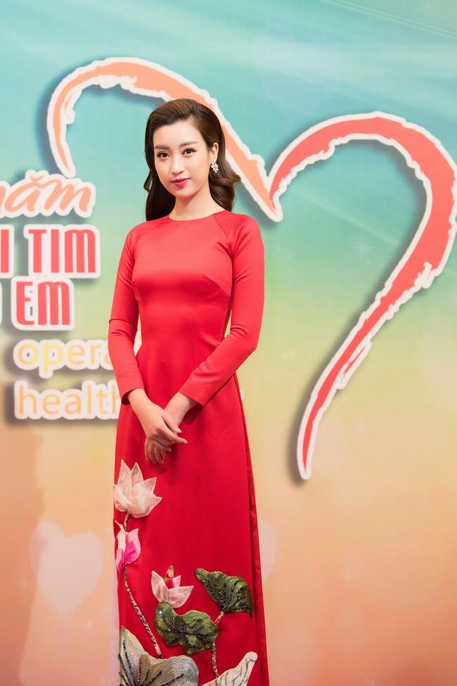 Hoa hậu Đỗ Mỹ Linh ngày càng mảnh mai khó tin, diện áo dài đỏ rực khi làm đại sứ - Ảnh 2.