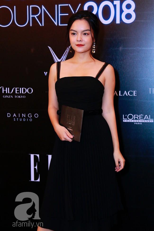 Phạm Quỳnh Anh diện váy đen đầy quyến rũ, Mỹ Tâm nam tính góc cạnh với tóc nâu môi trầm trên thảm đỏ Elle - Ảnh 1.