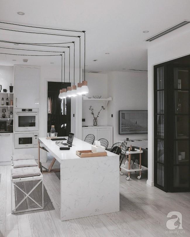 Căn hộ 74m² ở Hà Nội đẹp ấn tượng với gam màu trắng - đen của chàng trai là nhiếp ảnh gia ẩm thực - Ảnh 9.