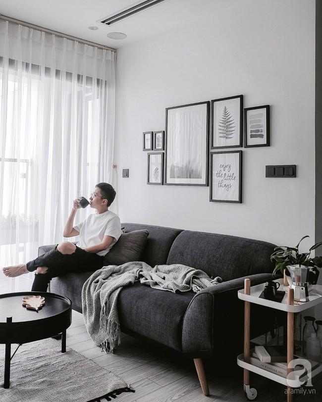 Căn hộ 74m² ở Hà Nội đẹp ấn tượng với gam màu trắng - đen của chàng trai là nhiếp ảnh gia ẩm thực - Ảnh 1.