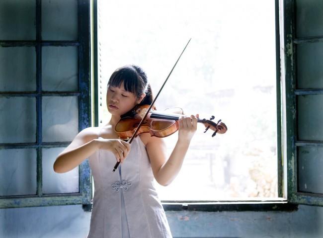 Thần đồng violin Đỗ Phương Nhi về nước biểu diễn chào năm mới ở Hà Nội - Ảnh 1.