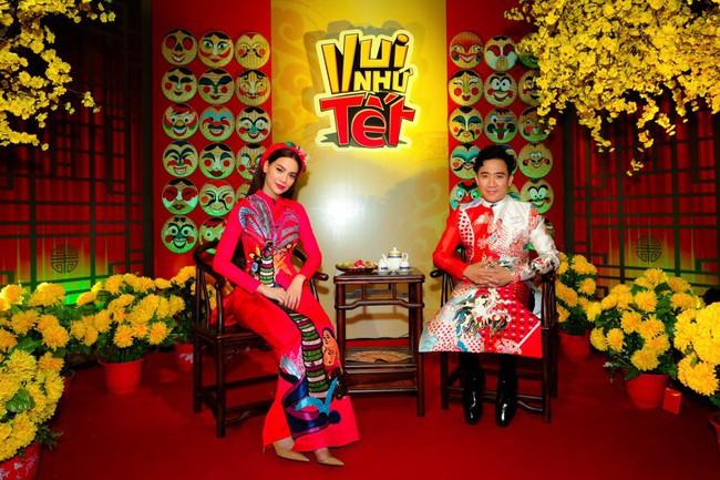 Bộ đôi Hồ Ngọc Hà - Trấn Thành trở lại, mặc áo dài rực rỡ dẫn chương trình Tết - Ảnh 1.