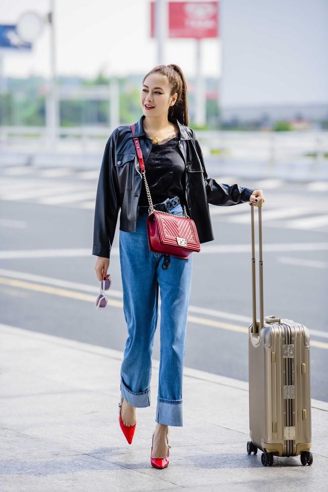 Sau tuyên bố không cần đại gia, Hoa hậu Tuyết Nga thả dáng tự tin với outfit cả trăm triệu đồng tại sân bay - Ảnh 1.