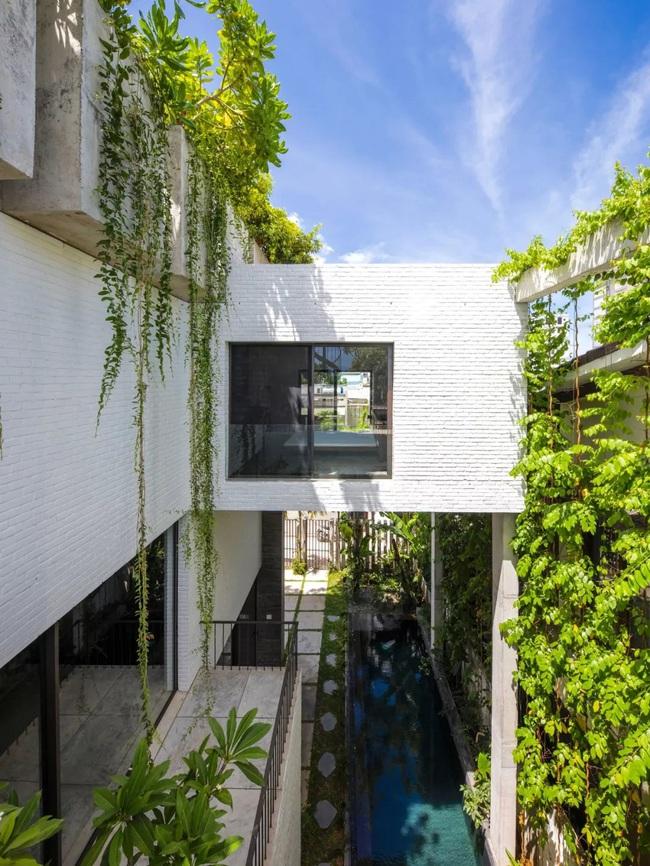 Ngôi nhà đầy gió tự nhiên, cây xanh và ánh sáng thân thiện với môi trường dành cho gia đình 5 người ở Đà Nẵng - Ảnh 4.