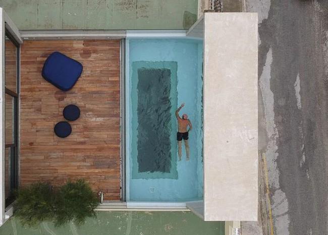 Ngắm kiến trúc nhà phố độc đáo với không gian hiện đại, có phòng tập thể dục, chiếu phim và hồ bơi trong suốt trên nóc nhà - Ảnh 14.